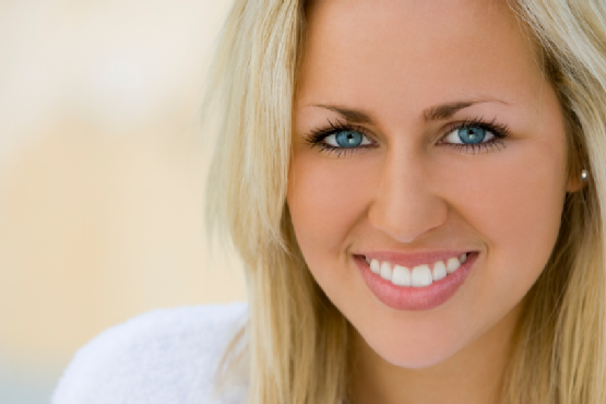 Portrait of A Beautifully Healthy Smiling Young Blond Woman